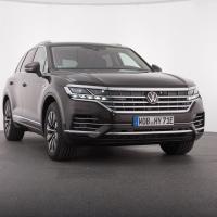 VW touareg 2.0 eV6 hybrid atmosphere. Cena avtomobila: 87.807 evrov, parkirni sistem Plus s parkirno asistenco: 846 evrov.